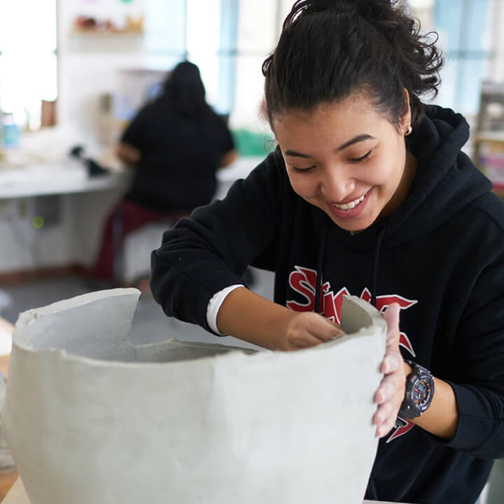 woman working with ceramics