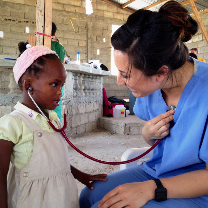 Nurse smiling with a little girl