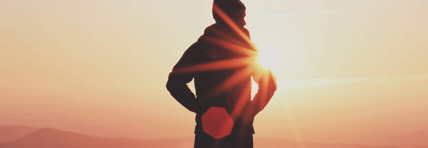 person standing in front of the sun
