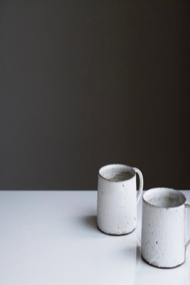 two ceramic coffee cups on a white table