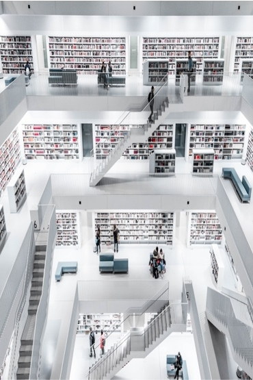 interior of three-story library filled with books and people