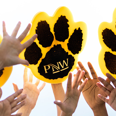Hands raised with PNW paw