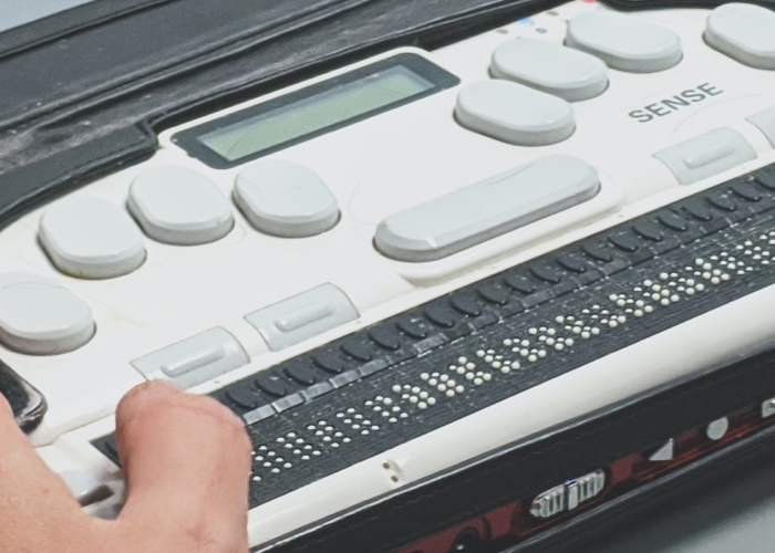 person using a braille keyboard