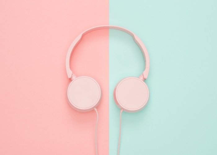 pink headphones on pink and turquoise background