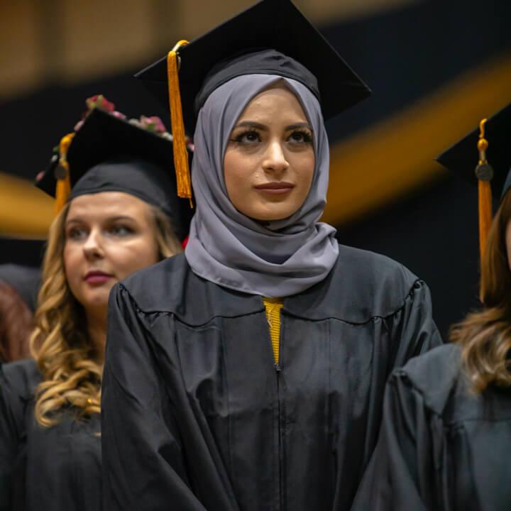Female PNW student in graduation regalia