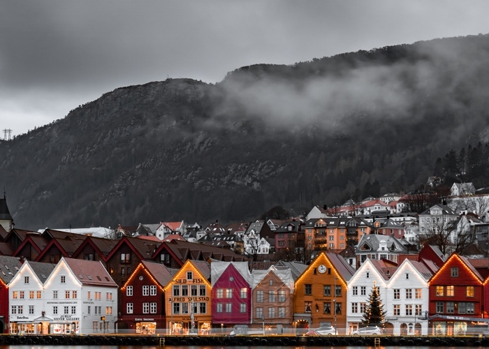 landscape view of Norwegian homes on a lake