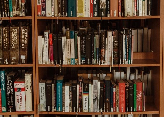 books stacked on a bookshelf