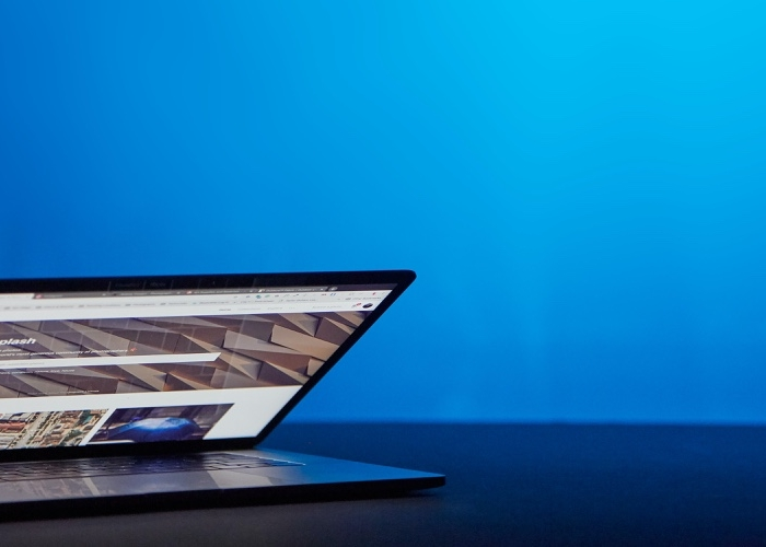 half open laptop with a blue lit background