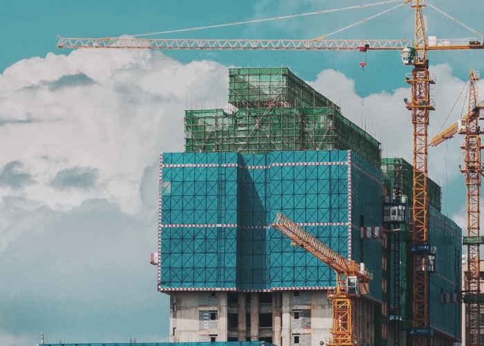 a crane amongst a skyline of uncompleted buildings